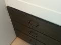 stained front panel drawers.